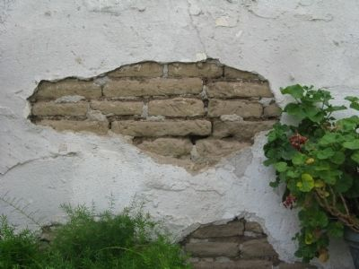 Exposed Adobe Bricks on Side of Building Photo, Click for full size