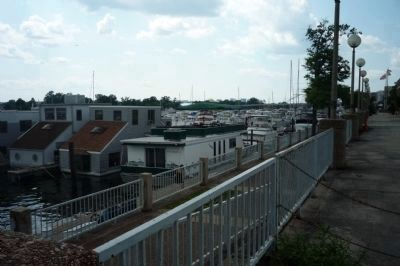 Houseboats moored on the Potomac, off the Harbor Street promenade. Photo, Click for full size
