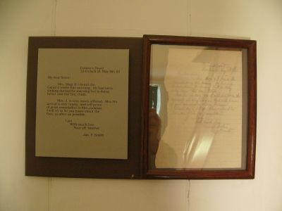 "A letter framed and displayed on a wall in the ""Death House"". image. Click for full size."