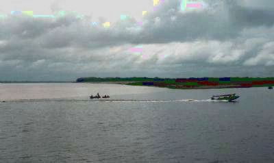 "Fishing boats at the ""Meeting of the Waters"" - in the rainforest below the Port of Manaus image. Click for full size."