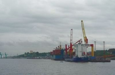 International commerce - containers being transferred between ships in the Port of Manaus image. Click for full size.