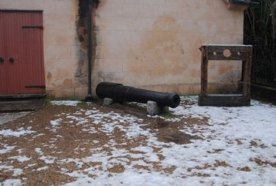 Pillory and old cannon image. Click for full size.