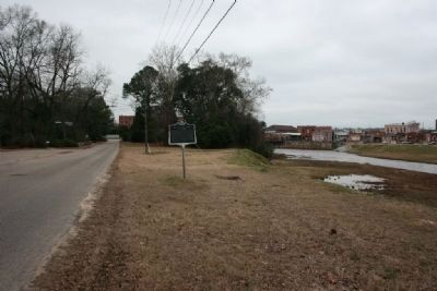 Old Plank Road Marker looking toward the Cotton Gin Factory & Town of Prattville on the right image, Click for more information