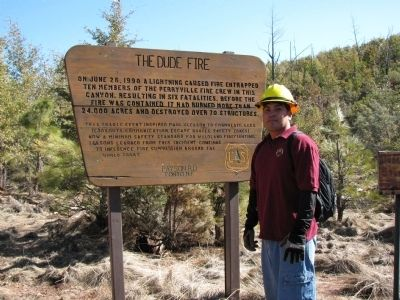 The Dude Fire Marker With West-Facing Slope of Walk Moore Canyon in Background image. Click for full size.