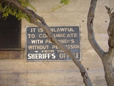 Sign on west wall of Mohave County Jail image. Click for full size.