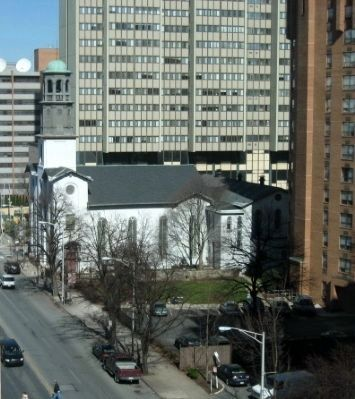 Old Salem Church holds its own among modern apartment and office buildings. image. Click for full size.