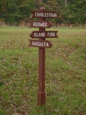 Sign Showing Directions to Four Major Settlements image. Click for full size.