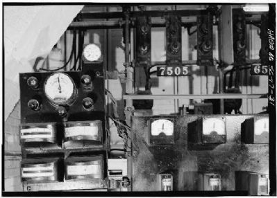 1896 Power Plant ,synchroscope and gauges, interlock disconnection switches on control panel image. Click for full size.