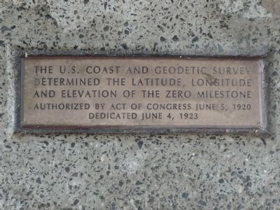 Close-up of plaque in the sidewalk below the north face of the monument image. Click for full size.