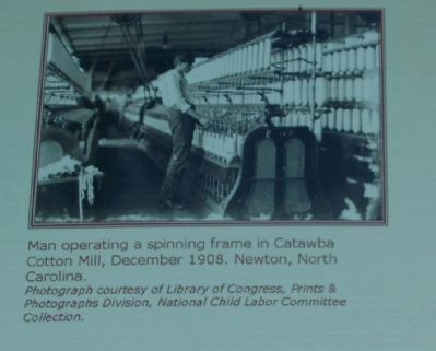 Man operating a spinning frame in Catawba Cotton Mill image. Click for full size.