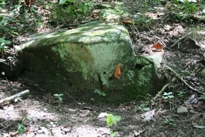 A rock located below a rifle pit with bullet holes. Photo, Click for full size