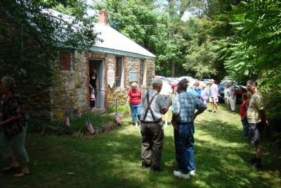 People waiting for their turn to enter Old Stone Schoolhouse Open House. image. Click for full size.
