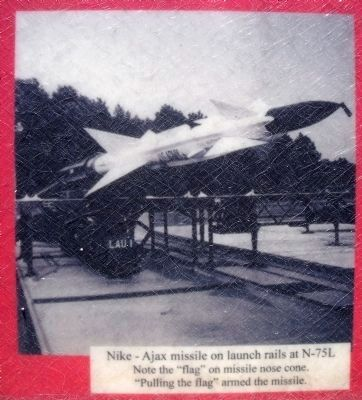 Nike–Ajax missile on launch rails at N-75L image. Click for full size.
