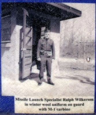 Missile Launch Specialist Ralph Wilkerson in winter wool uniform on guard with M-1 carbine image. Click for full size.