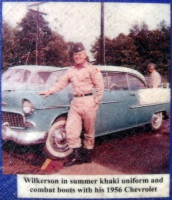 Wilkerson in summer khaki uniform and combat boots with his 1956 Chevrolet image. Click for full size.