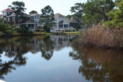 view of a portion of the Bethany Beach Loop Canal , near the marker, seen today image. Click for full size.