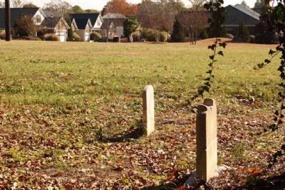 Saluda Factory Cemetery Marker (Background) , last remaining visible headstones seen here image. Click for full size.