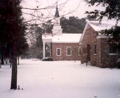 Bluffton United Methodist Church snow covered the church grounds image. Click for full size.