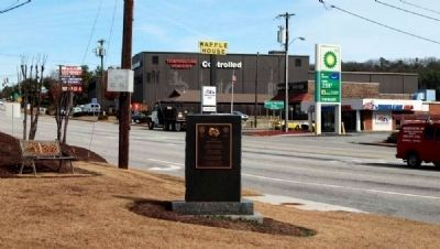 Deputy Marcus L. Whitfield Marker -<br>Waffle House Where Shooting<br>Took Place in Distance Photo, Click for full size
