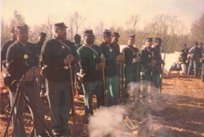 Black Civil War re-enactors from the District of Columbia muster in camp prior to re-staging image. Click for full size.