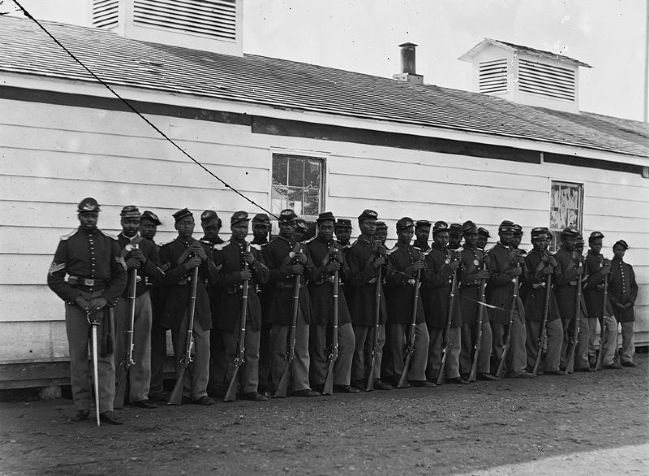 E Company, 4th U.S. Colored Infantry - detachment on duty at Fort Lincoln in 1864. Photo, Click for full size