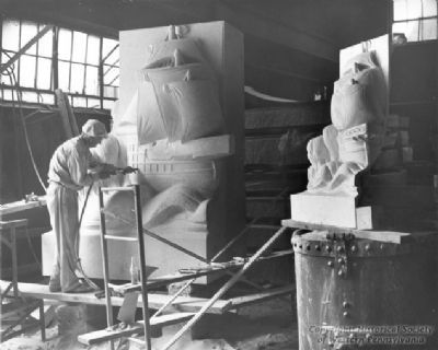The sculptor shapes the base of the Christopher Columbus statue Photo, Click for full size