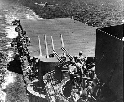 "Hellcat fighter landing on ""Lady Lex"" (CV-16) during Battle of the Philippine Sea, 19 June, 1944. image. Click for full size."