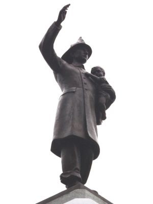 Closeup of Fireman Statue Photo, Click for full size