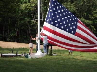 Flag Raising at Theodore Roosevelt Flagpole image. Click for full size.