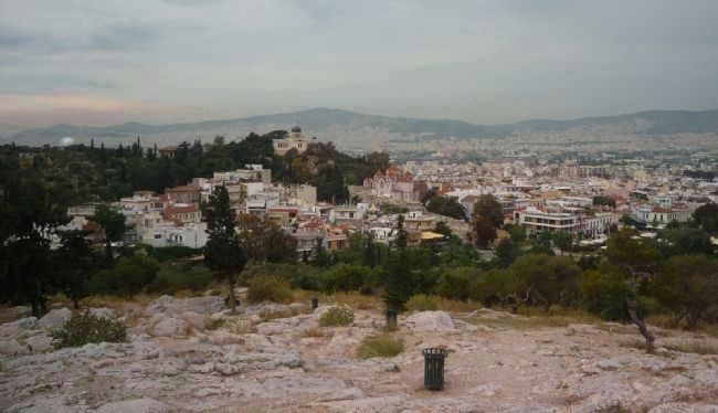 View toward central Athens from Areopagus Hill, a high rock outcrop in Parko Thiseio image. Click for full size.
