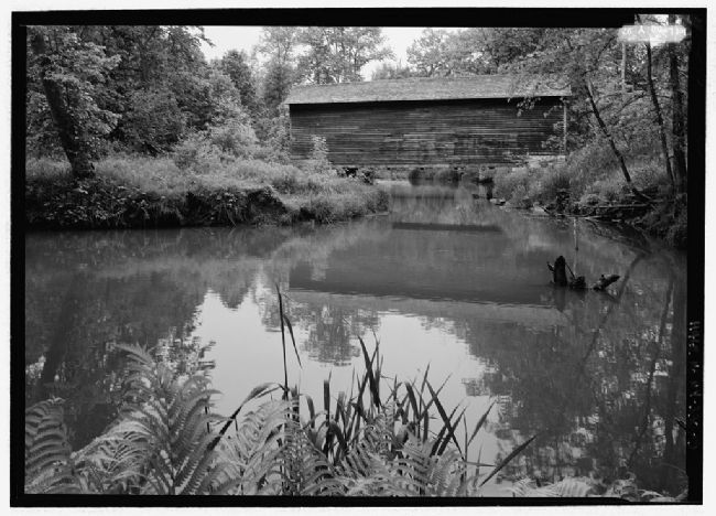 Hyde Hall Covered Bridge spans the placid Shadow Brook image. Click for full size.