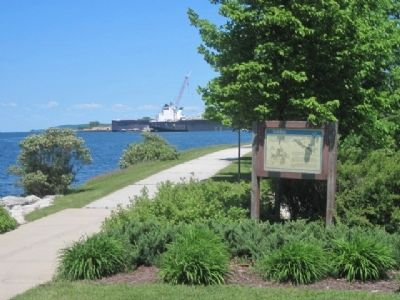 The Old Bridge Marker and Lake Freighter at Bay Shipbuilding image. Click for full size.