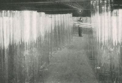 Cylinders of window glass stored ready for flattening image. Click for full size.
