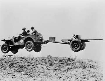 "A Bantam ""peep car"" or ""jeep"" negotiating rough terrain during test trials for the U.S. Army image. Click for full size."