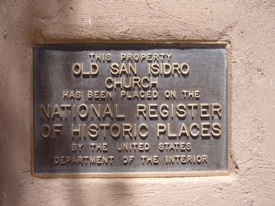 Plaque to the left of Iglesia De San Ysidro entrance image. Click for full size.