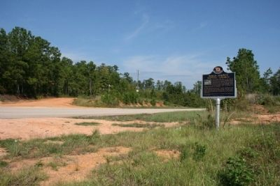 The dirt road across from the marker is the road to Indian Springs Baptist Church image. Click for full size.
