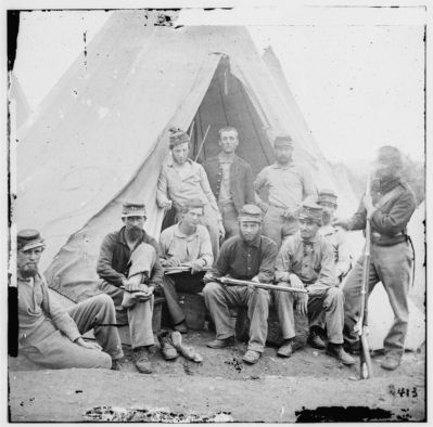 "Group of soldiers of Company G, 71st New York Vols. In front of 'Sibley"" tent image. Click for full size."