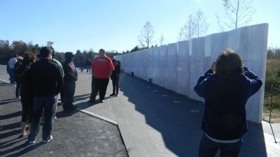 Flight 93 Memorial Wall - marking the course of the airliner over the crash site image. Click for full size.