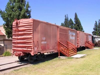Railroad Cars on Display Near the Depot Building image. Click for full size.