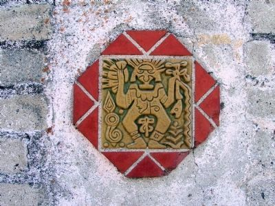 Pottery Tile Embedded in the Fence image. Click for full size.