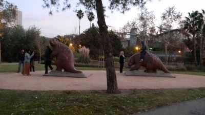 "Tourists pose with life-sized models of giant sloths in the ""Pleistocene Garden"" image. Click for full size."