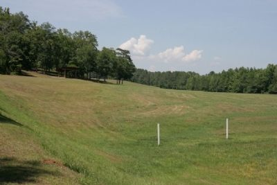 From the log barricade position, the gun placement is to the left behind the tree line. image. Click for full size.