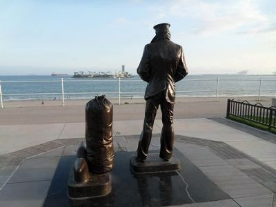 Lone Sailor overlooking the ocean. image. Click for full size.