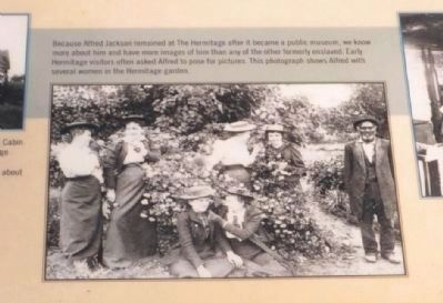 Alfred with several women in the Hermitage garden. image. Click for full size.