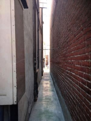 Alley to The Canary Cottage & <br> Pan Tan Gambling House image. Click for full size.