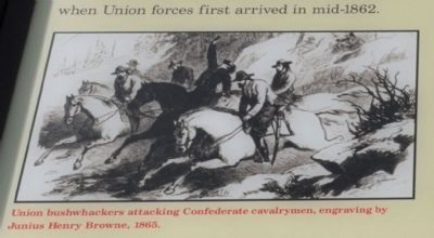 Union bushwhackers attacking Confederate cavalrymen, image. Click for full size.