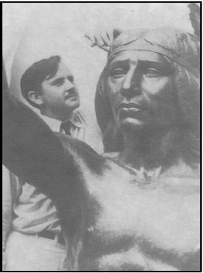 William Gordon Huff putting finishing touches on his bronze statue of Chief Solano image. Click for full size.