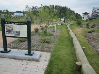 Timbers mark the course of the colonial causeway. image. Click for full size.