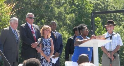 Community officials and UCAAC coordinators at the podium, June 16, 2012 image. Click for full size.