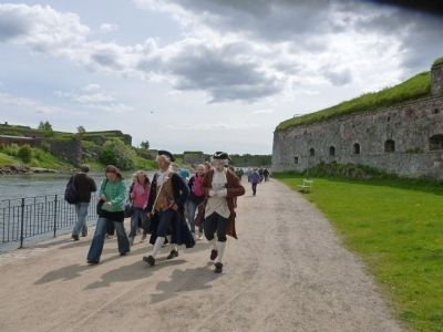 Tourists follow period re-enactors depicting 18th century garrison life in the fortress image. Click for full size.